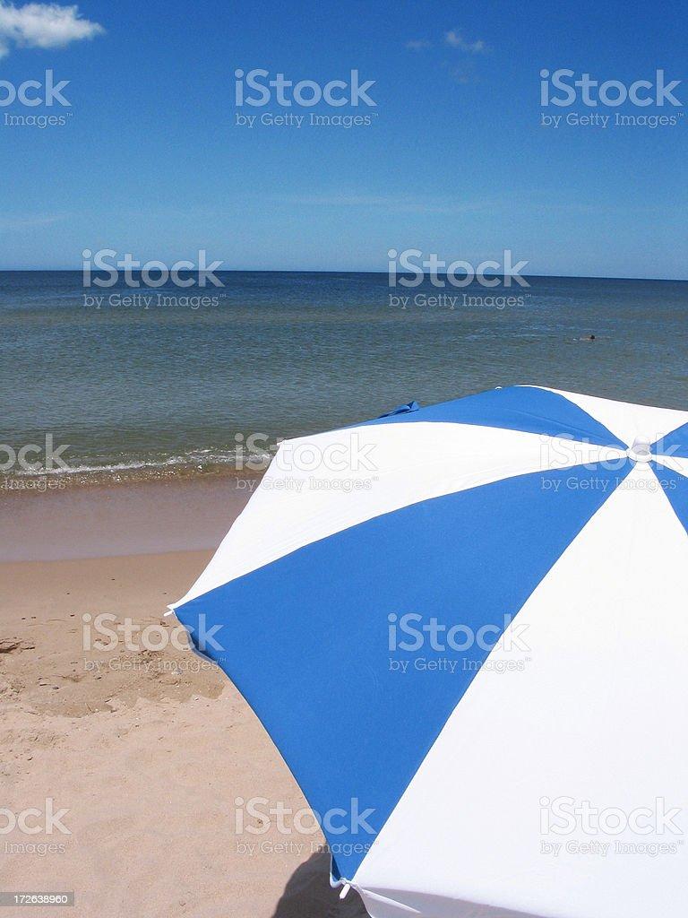 Beach peace (umbrella near the sea) royalty-free stock photo