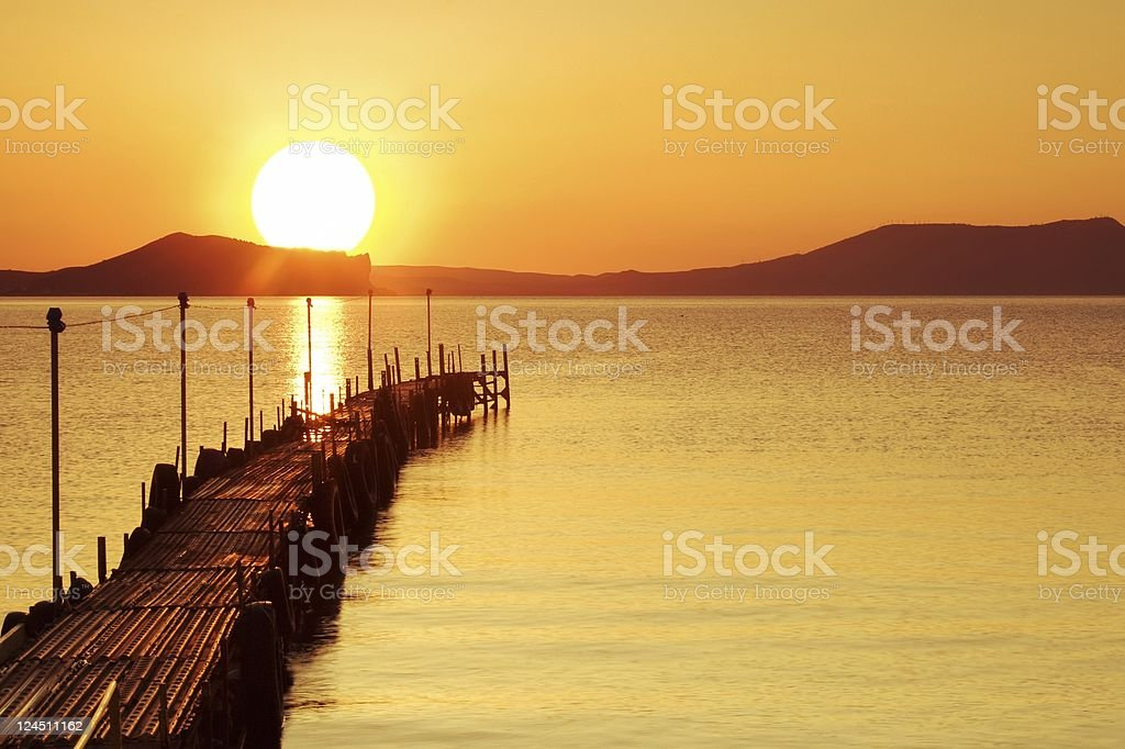 Beach pier at sunrise royalty-free stock photo