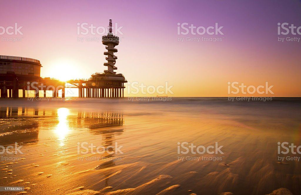 Beach pier reflection stock photo