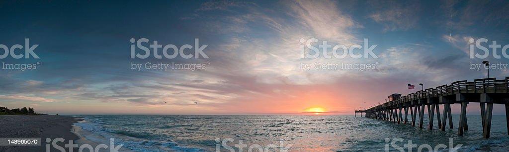 Beach pier sunset Venice Florida stock photo