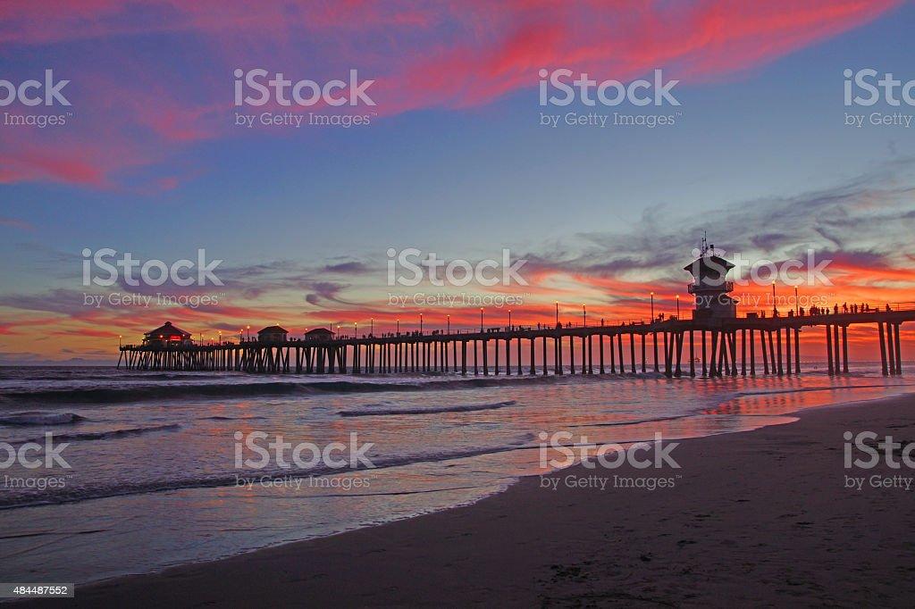 Beach pier sunset wide angle stock photo
