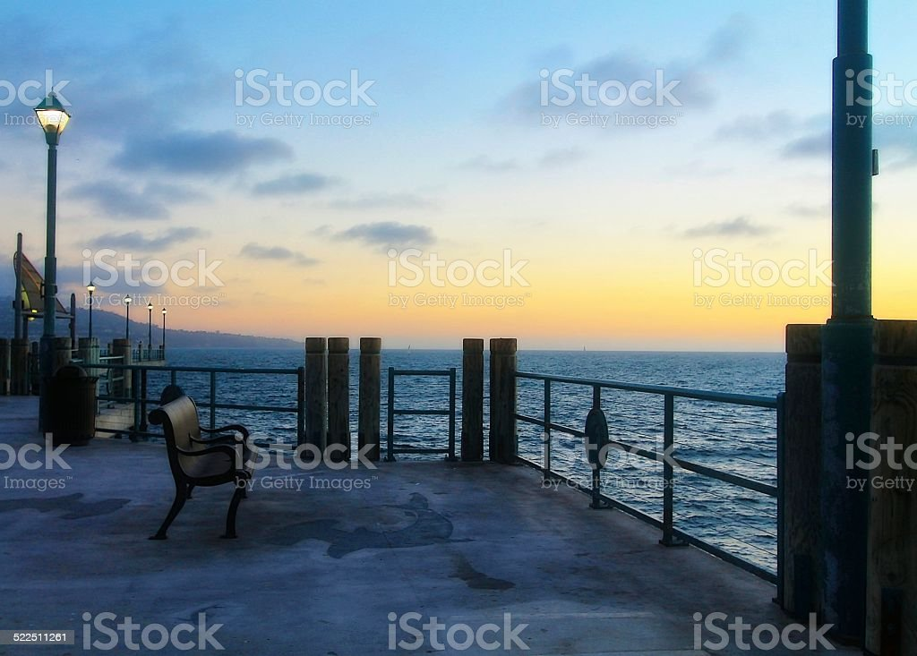 Beach pier with the sunset view stock photo