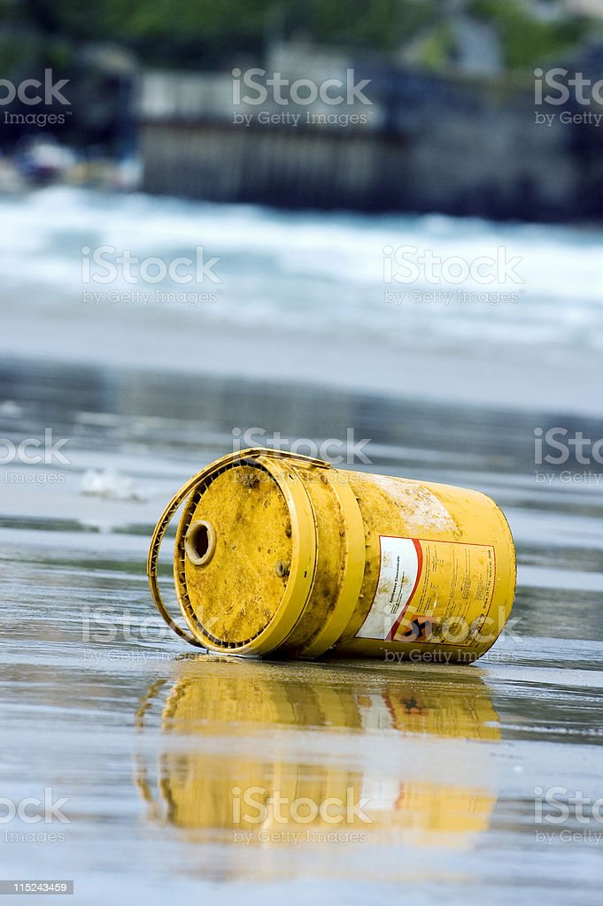 Beach Pollution - Chemical barrel on beach stock photo