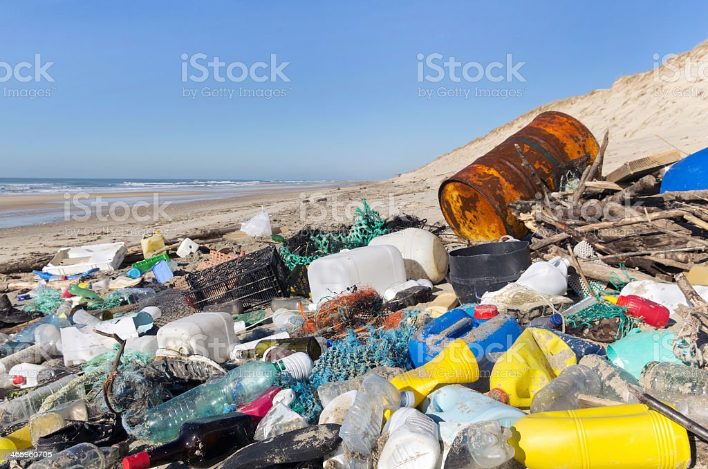 beach pollution, plastic and waste from ocean stock photo