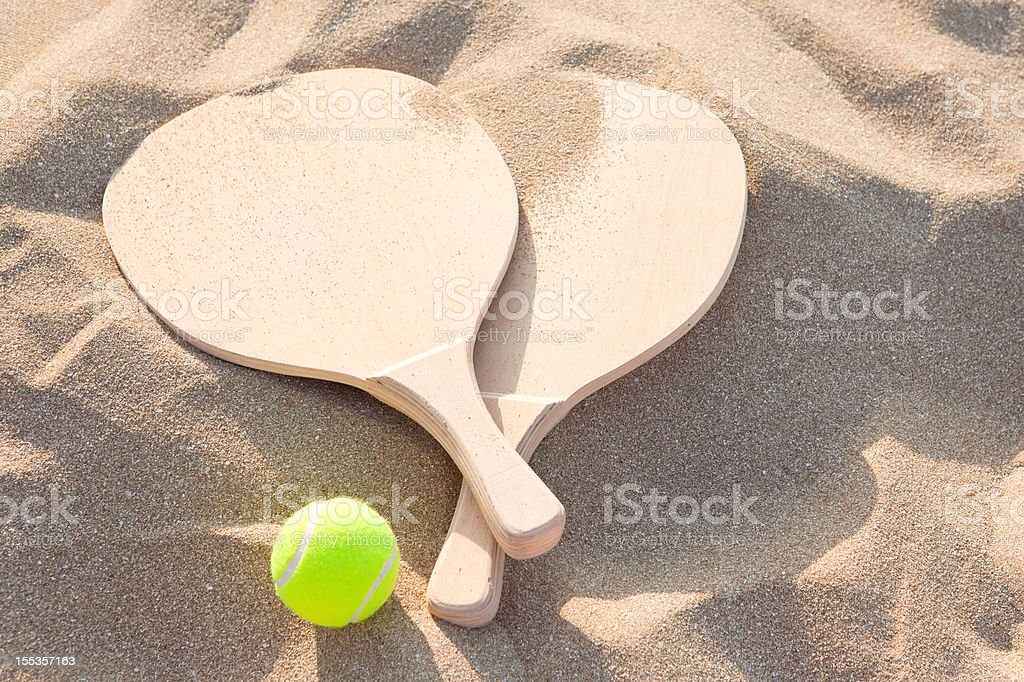 beach  racquets and ball stock photo