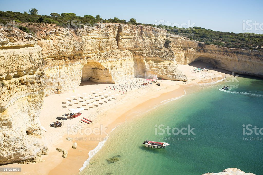 beach ready to relax tourists at Praia da Marinha stock photo