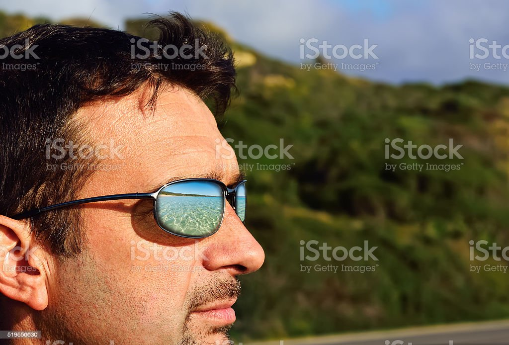 beach reflected in sunglasses lens stock photo