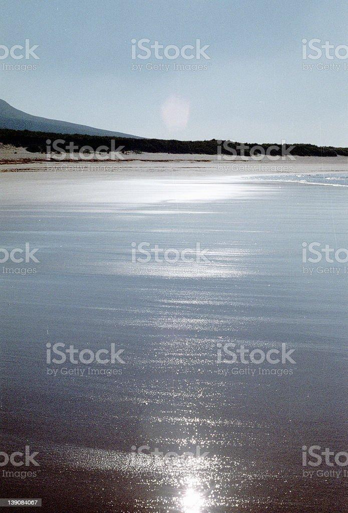 Beach reflecting the sun royalty-free stock photo