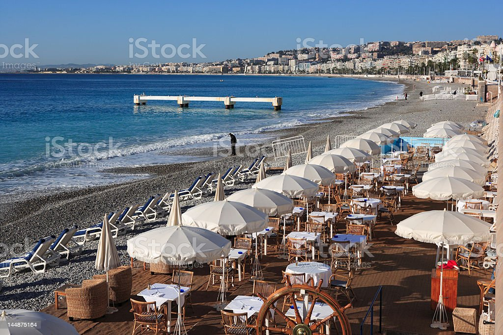 beach restaurant with sunshades at Nice, French Riviera royalty-free stock photo