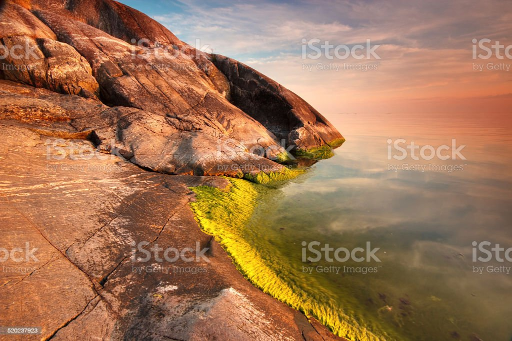 Beach rock  and still water landscape royalty-free stock photo