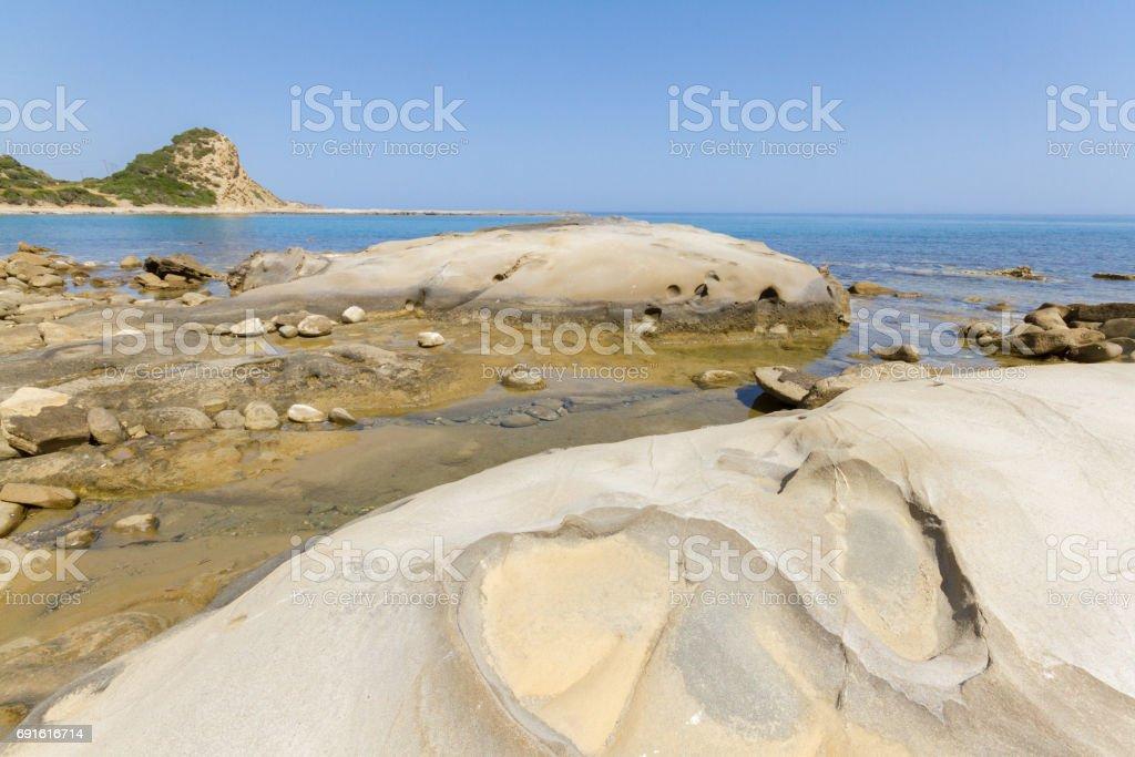 Beach rocks in Karpasia, island of Cyprus stock photo