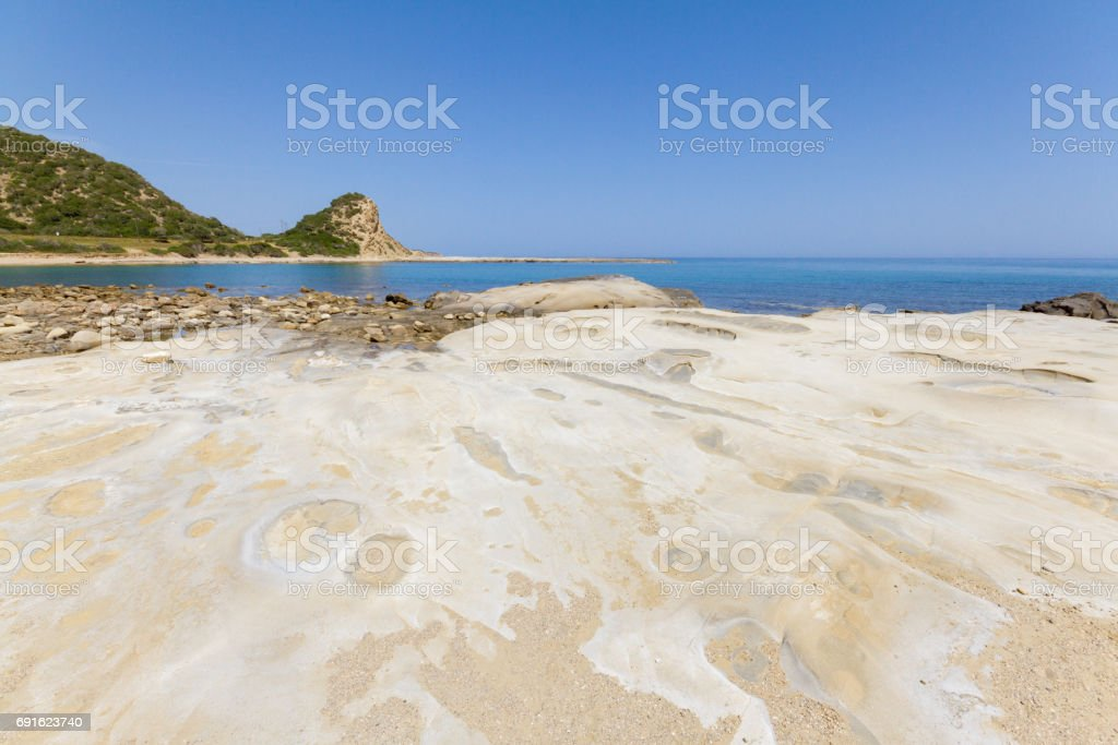 Beach rocks with craters close-up in Karpasia, island of Cyprus stock photo