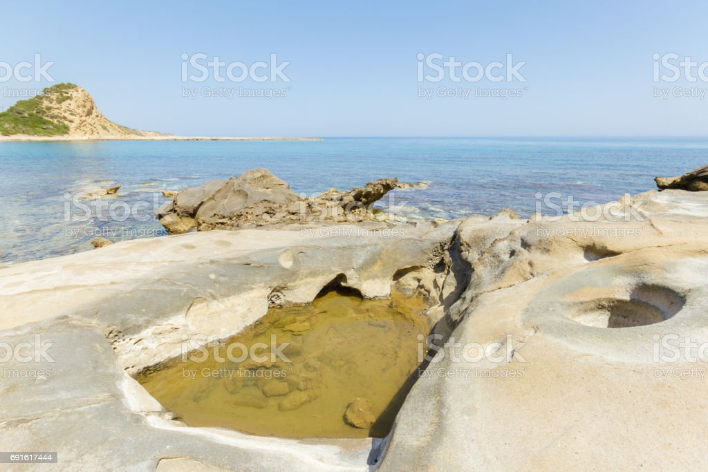 Beach rocks with craters in Karpasia, island of Cyprus stock photo