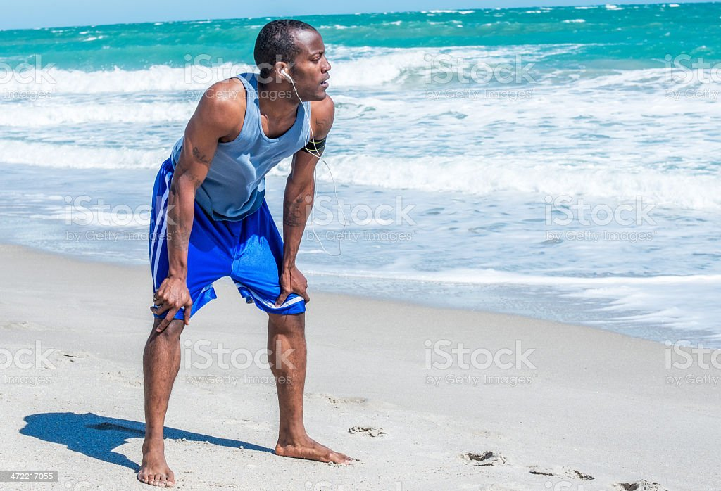 Beach Runner Taking a Break stock photo