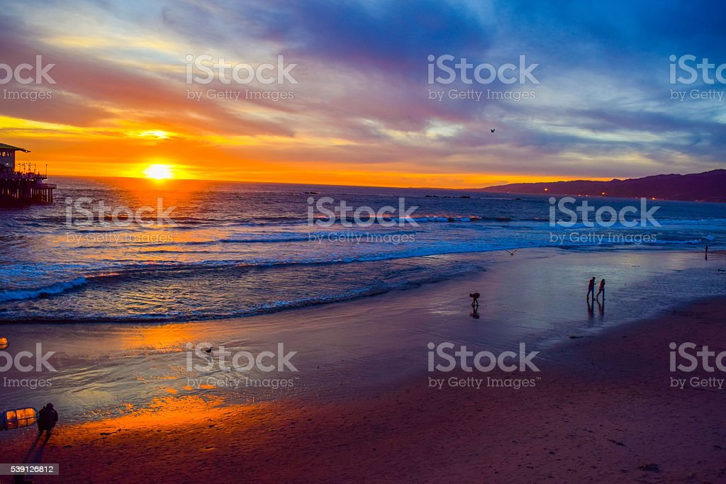 Beach Santa Monica pier at sunset, Los Angeles stock photo