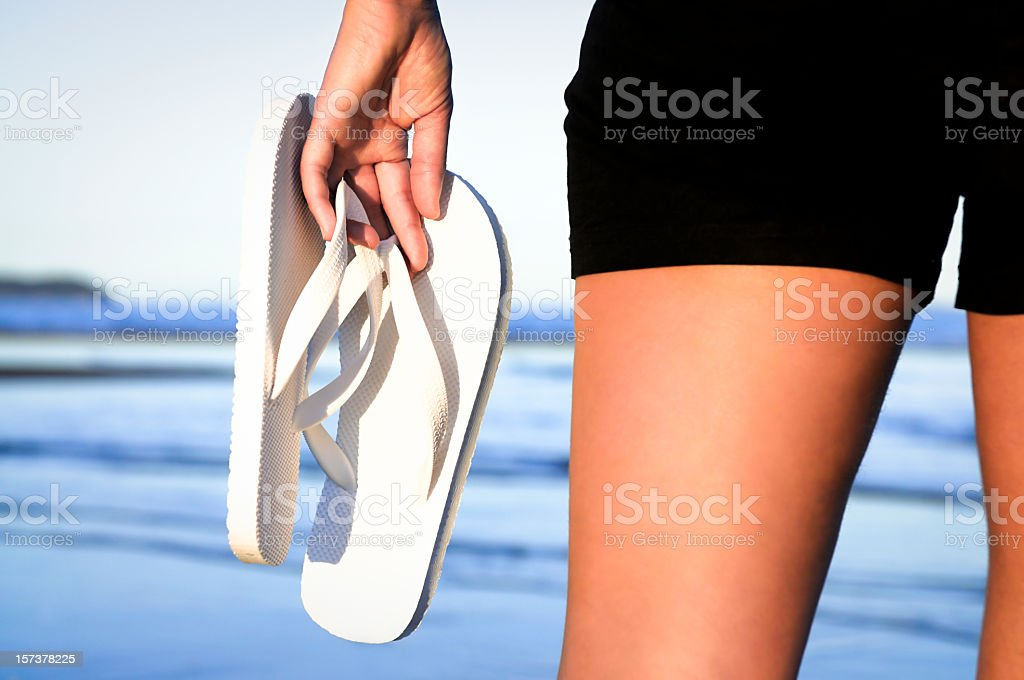 Beach Scene: Carrying Flip-Flops stock photo