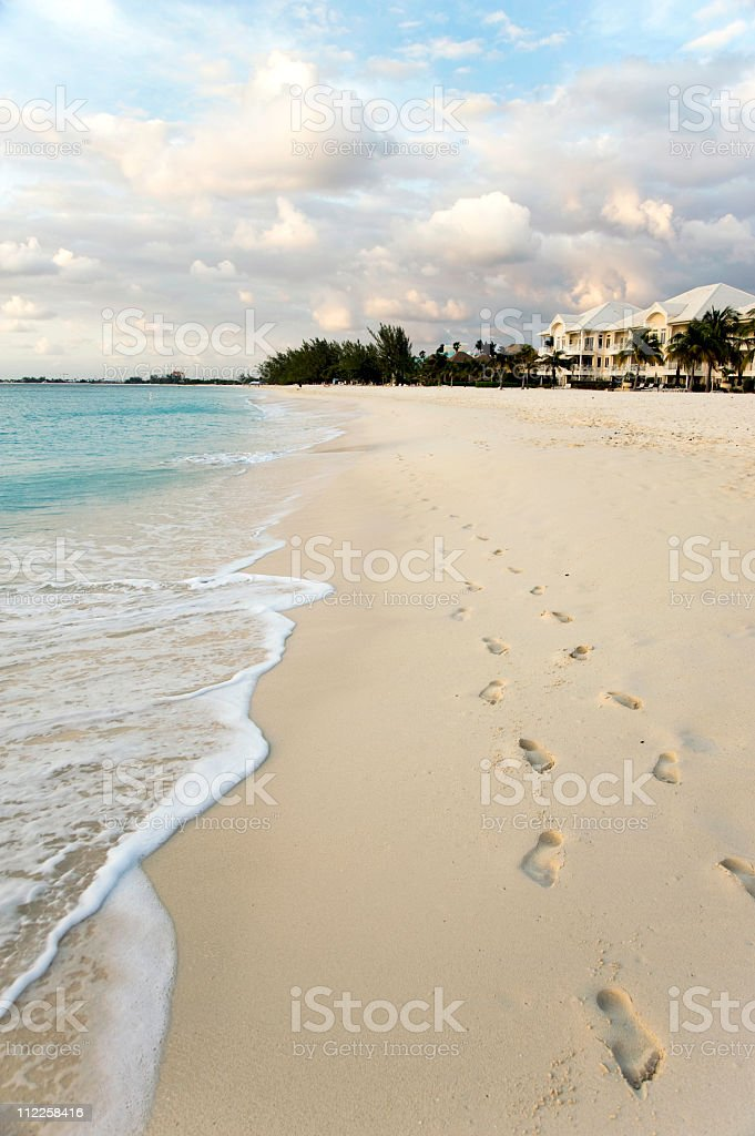 Beach scene footprints stock photo