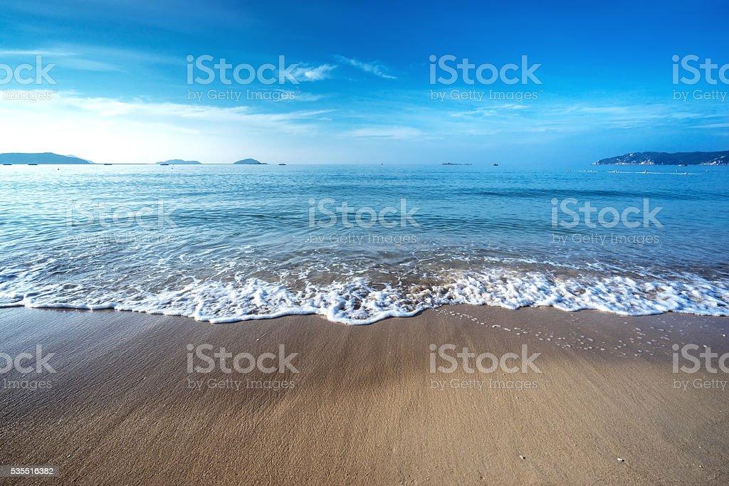 Beach scene showing sand, sea and sky stock photo
