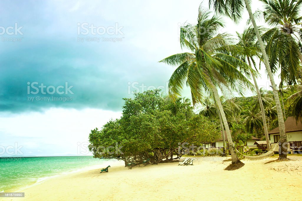 Beach scene showing sand, sea, sky and island royalty-free stock photo