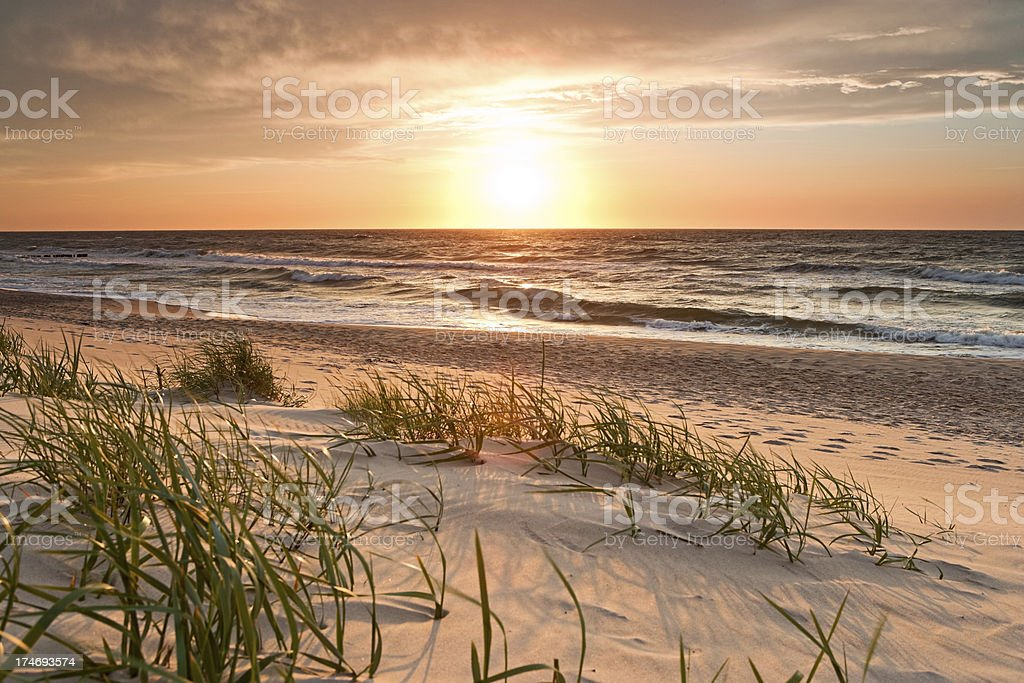 Beach scene showing sunset over the Baltic Sea royalty-free stock photo