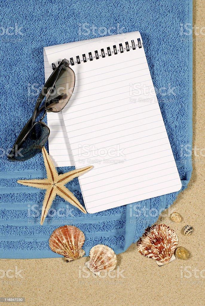 Beach scene with blank book royalty-free stock photo