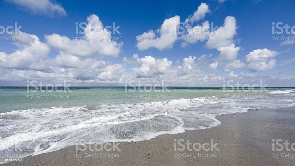 Beach scenics with waves and beautiful cloudscape (XL) stock photo