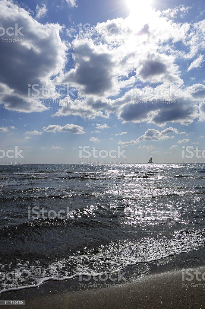 beach sea sail clouds royalty-free stock photo