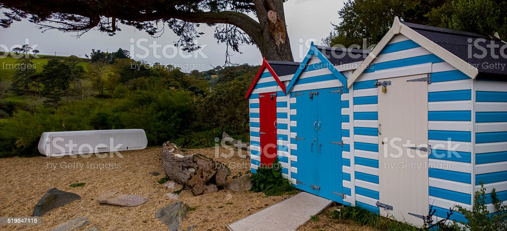 Beach shacks on a beach in devon stock photo
