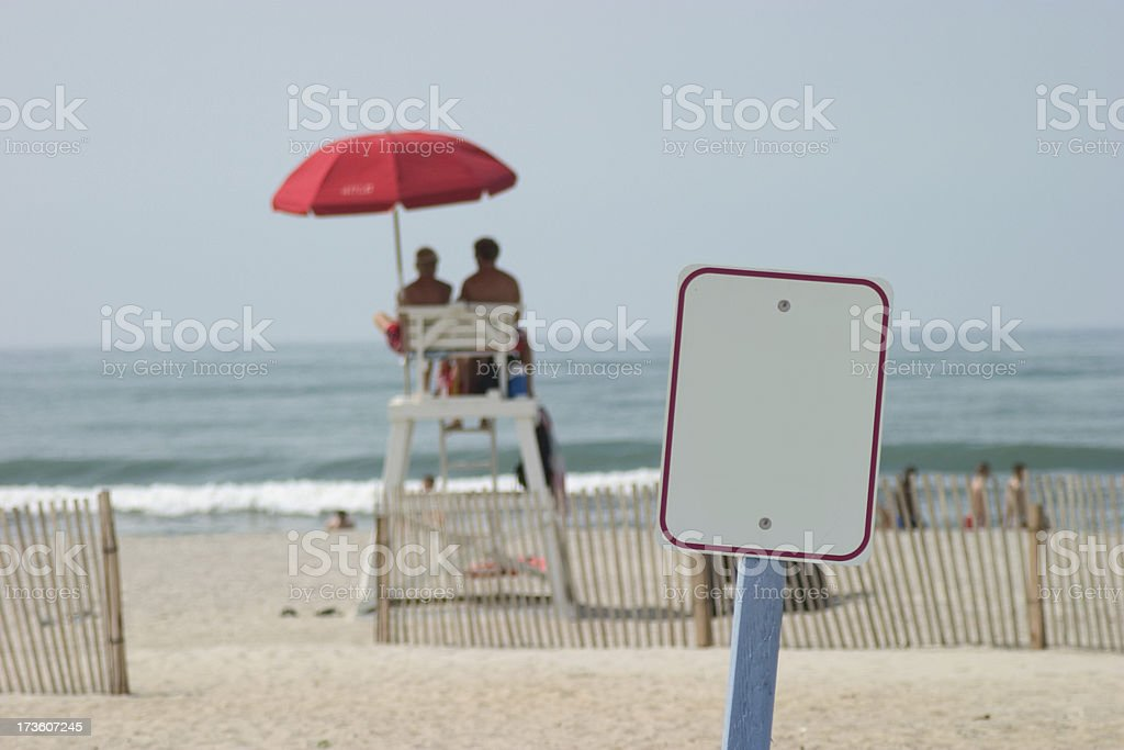 Beach sign and lifeguards royalty-free stock photo
