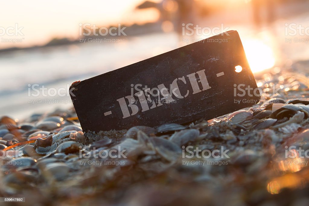 Beach Sign and sunset stock photo
