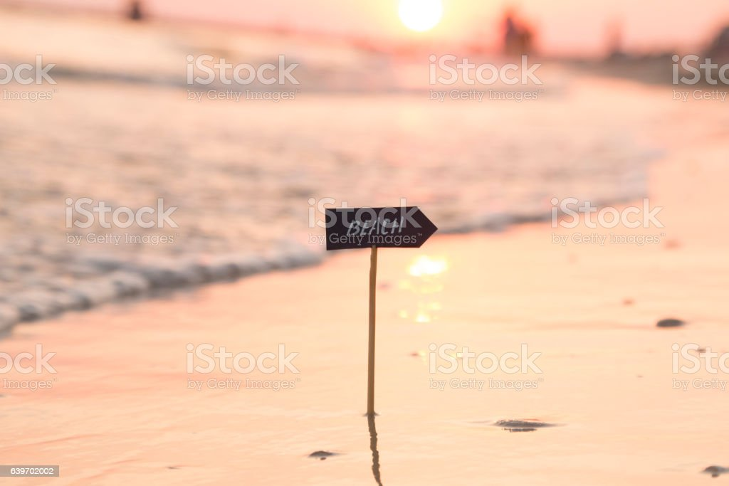 beach sign and sunset, Vacation or holidays idea stock photo