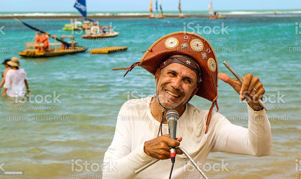 Beach singer in northeast Brazil stock photo
