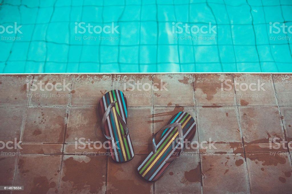 beach slippers flip flops near sport pool stock photo