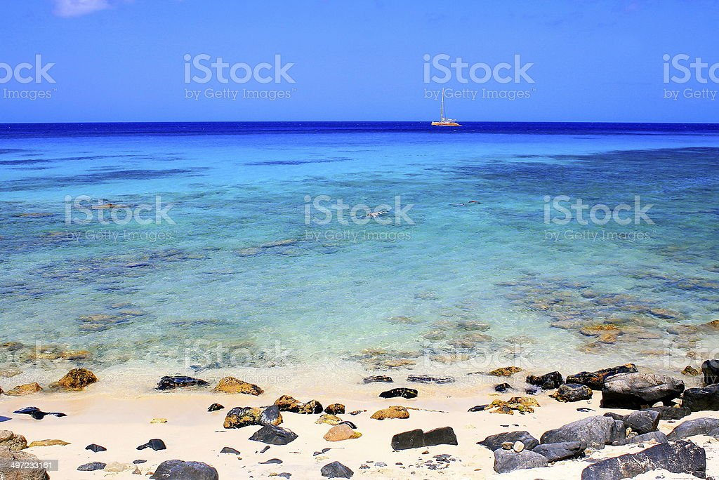 Beach Snorkeling with boat, Aruba - Caribbean Blue sea stock photo