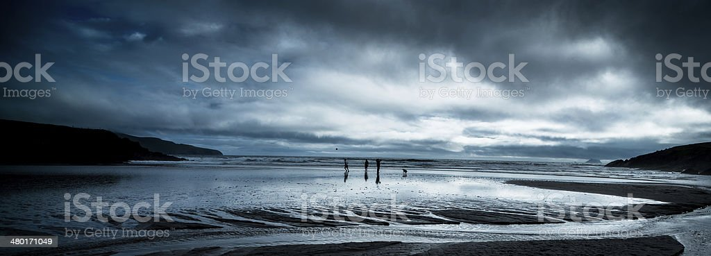 Beach soccer in Ireland with storm approaching royalty-free stock photo