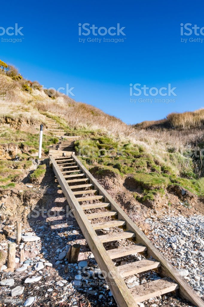 Beach Steps up a cliff stock photo