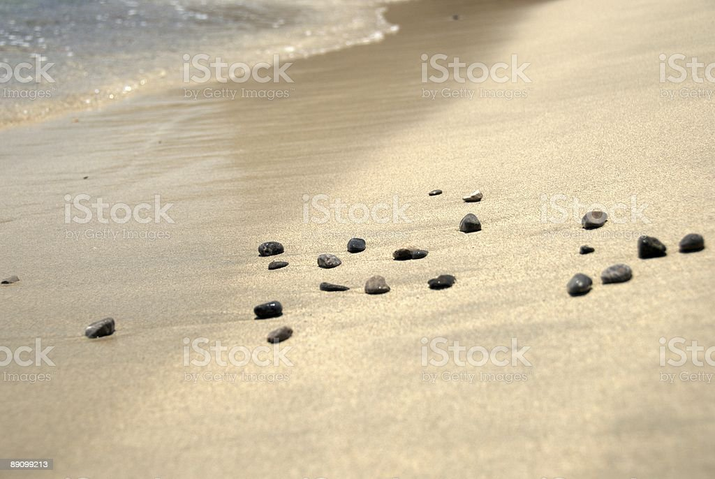 Beach stones (pebbles) and the wave royalty-free stock photo
