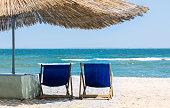 Beach straw umbrella from the sun on the beach
