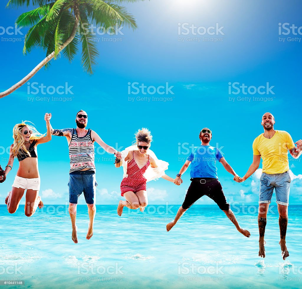 Beach Summer Friends Jumping Happiness Concept stock photo