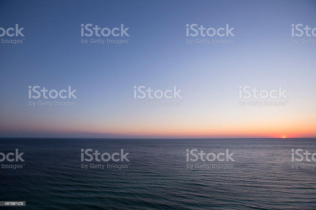 Beach Sunset on the Horizon stock photo
