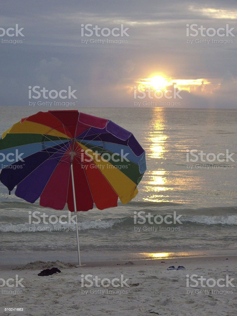 Beach Sunset With Parasol stock photo