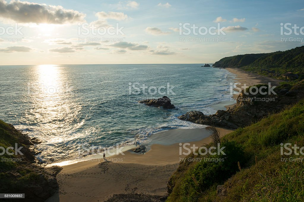 Beach sunset with people in Mazunte, Mexico stock photo