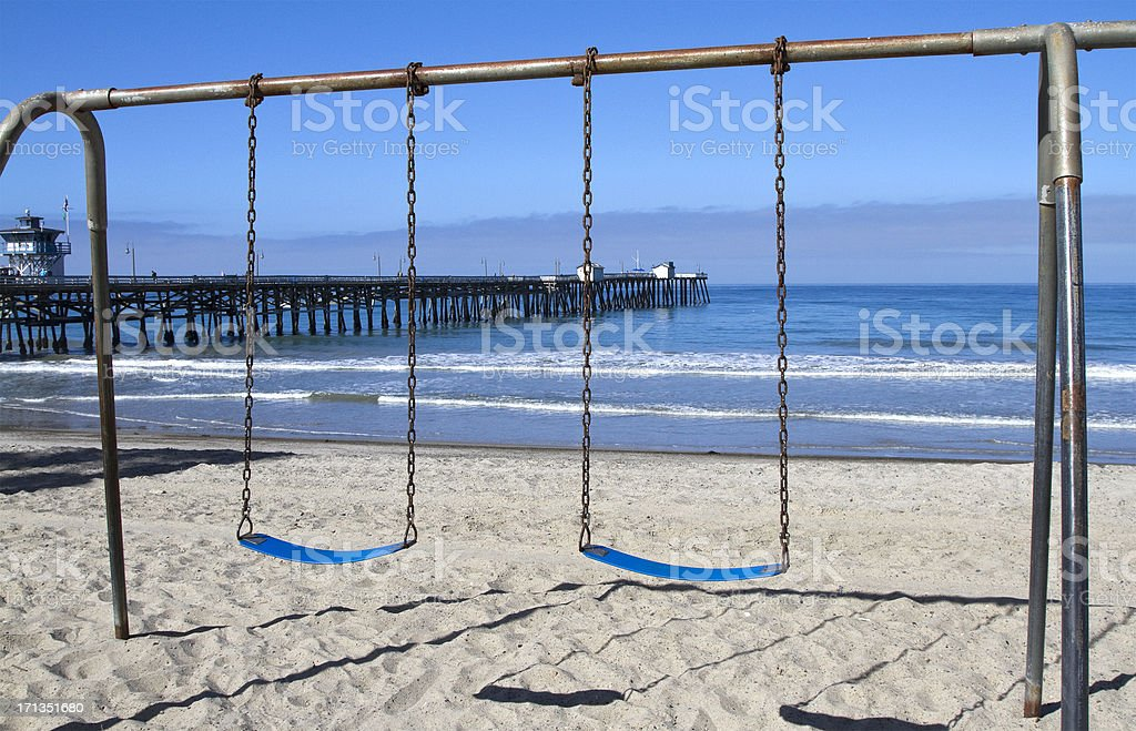 beach swings stock photo