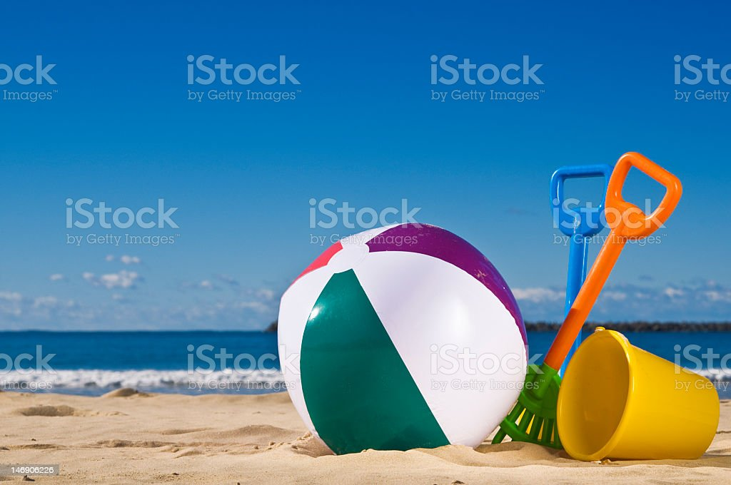 Beach toys sitting on the beach stock photo
