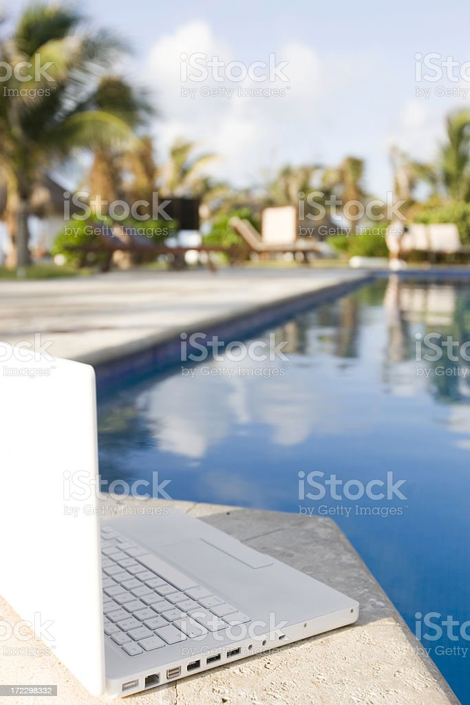 Beach Tropical Resort with Laptop at Empty Pool, Copy Space stock photo
