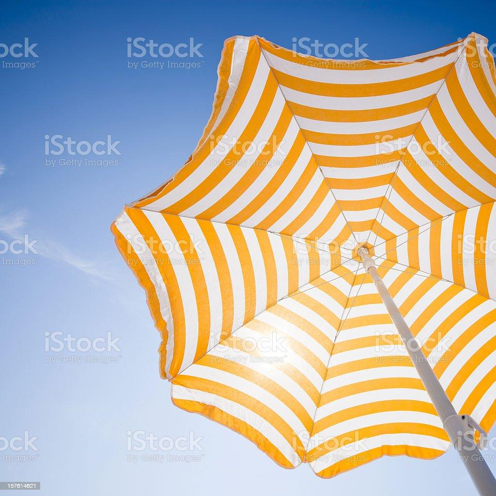 Beach umbrella against blue morning sky stock photo