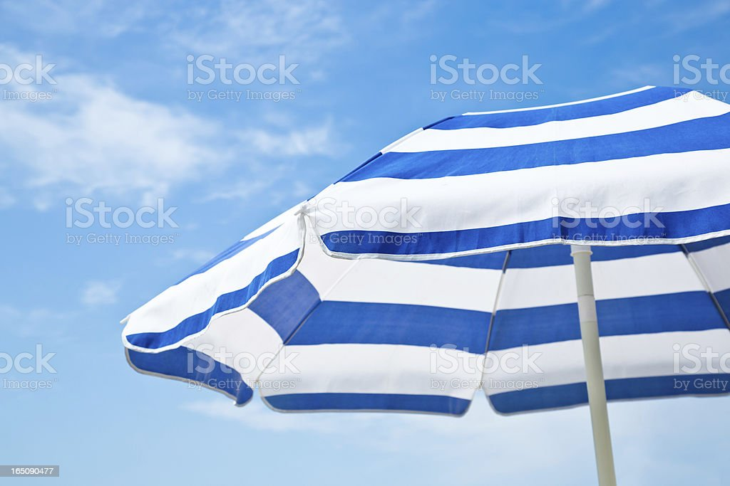 Beach umbrella against blue morning sky royalty-free stock photo