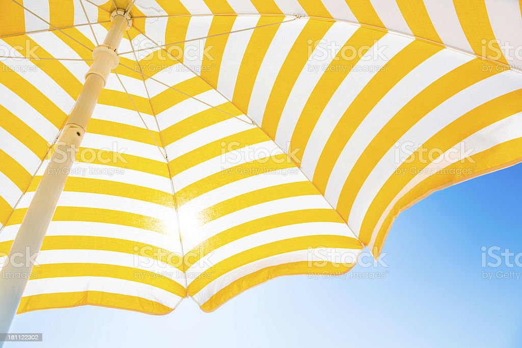 Beach umbrella against blue morning sky royalty-free stock photo