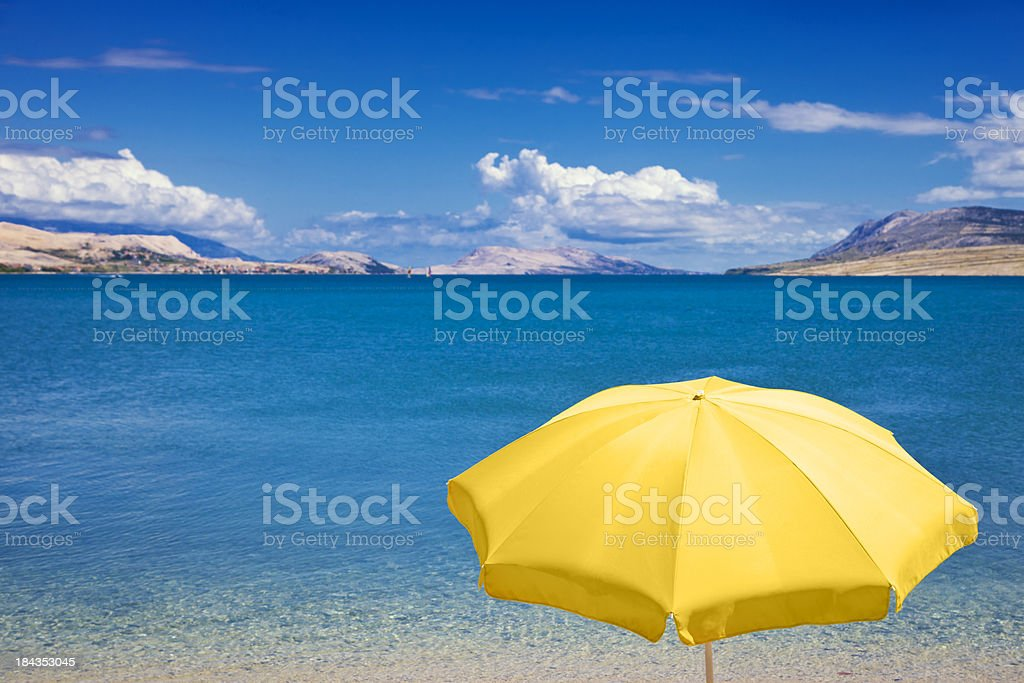 Beach umbrella against blue sky and sea stock photo