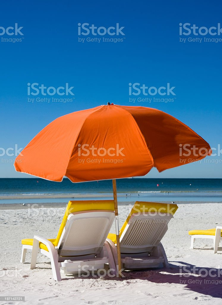 Beach Umbrella and Lounge Chair royalty-free stock photo